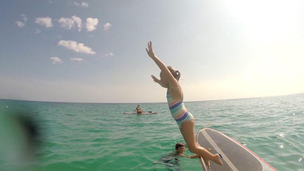 Paddle Boarding in Destin Florida - Mattie Jumping Off Board