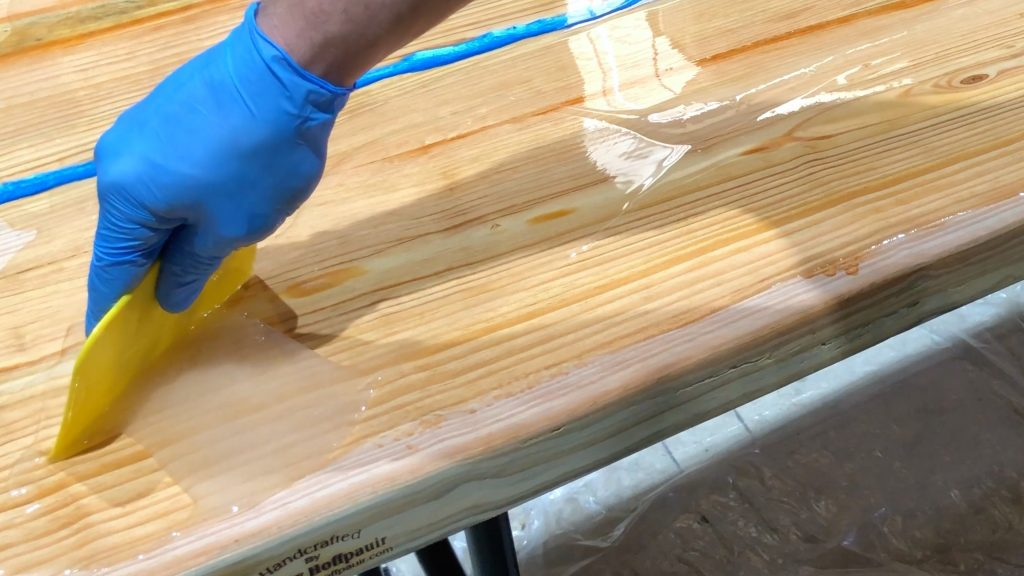 how to make a rustic table with epoxy resin - stonecoat epoxy spread