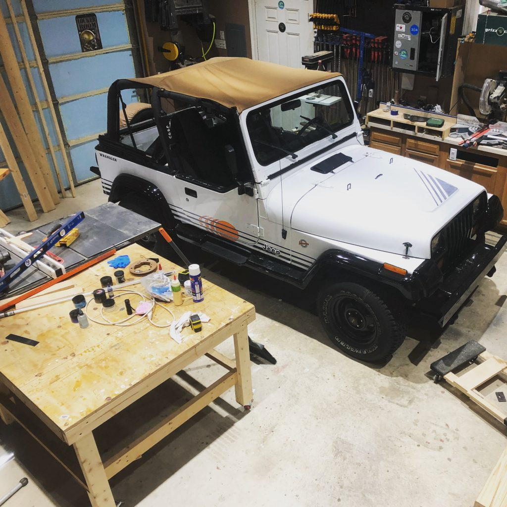 how to spray bed liner in a jeep wrangler interior - parked in workshop