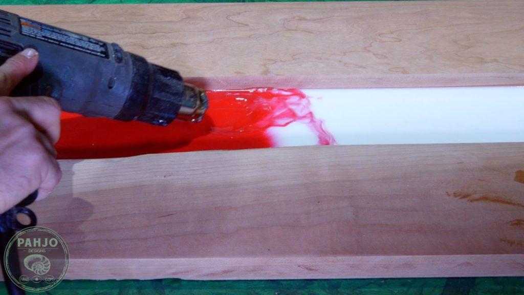 DIY Wood and Resin Wall Art - Baseball Storage Rack_Heat Gun Lacing Effect