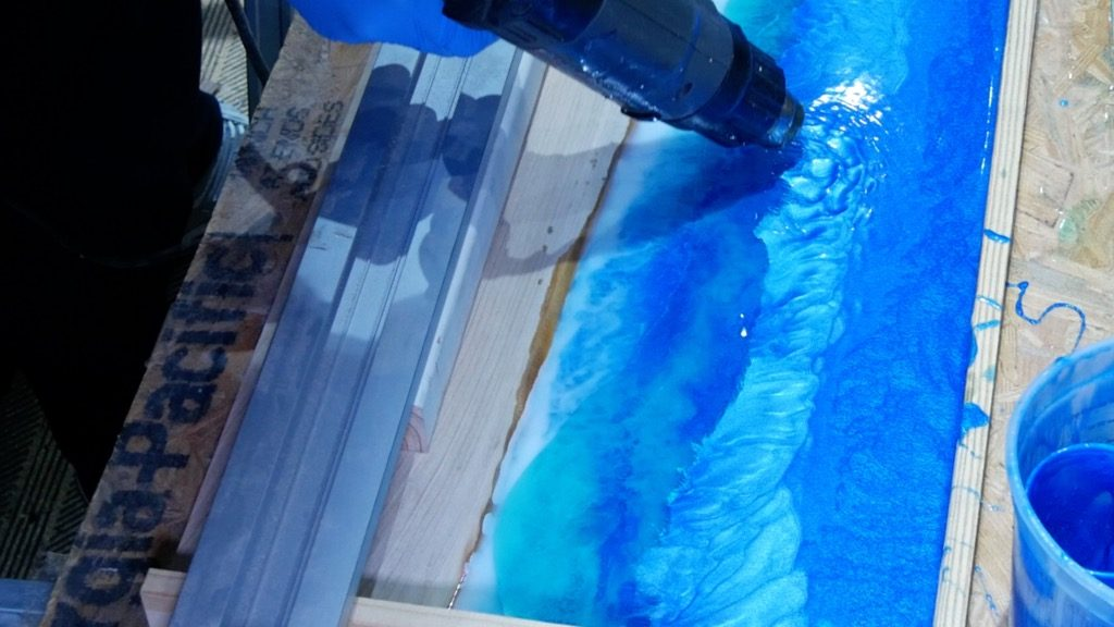 mix resin ocean colors with heat gun