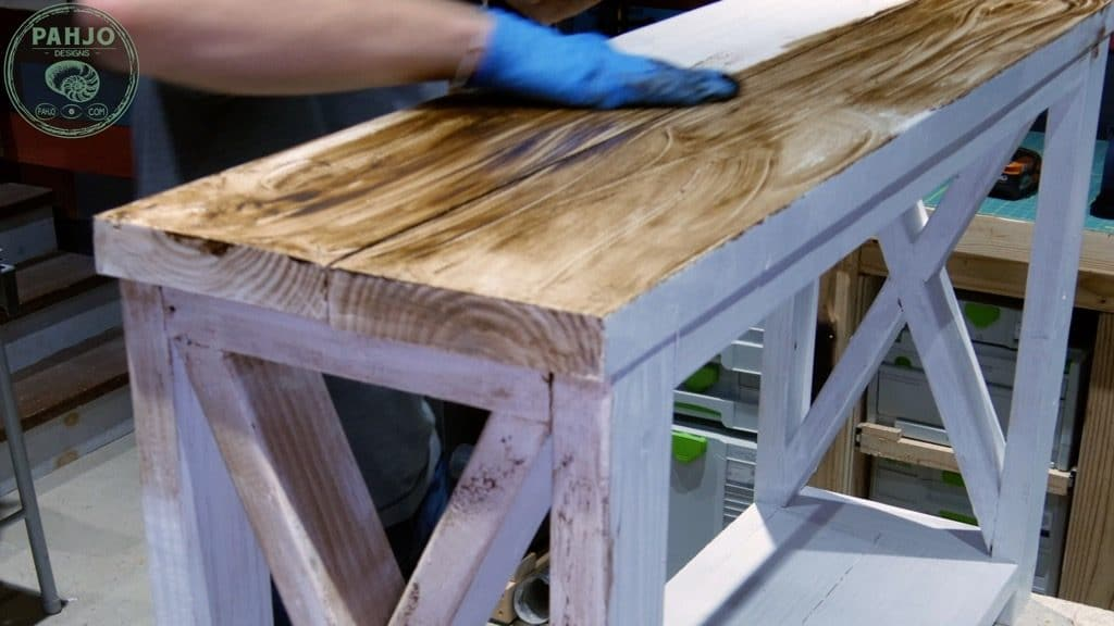 use hand to apply dark creme wax to distress painted furniture